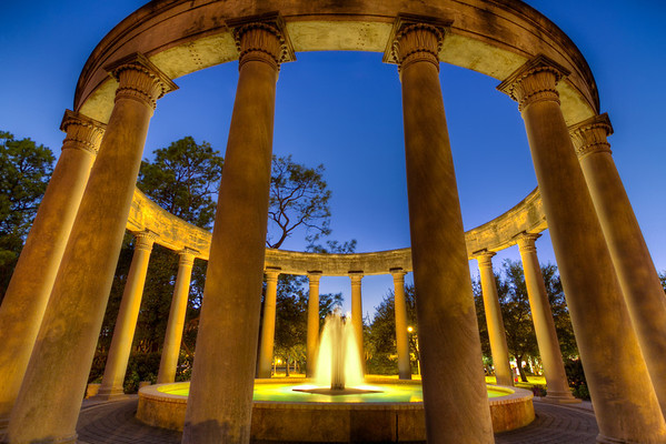 Mecom Rockwell Colonnade and Fountain<br /> A recent walk around the entrance to Herman Park in Houston brought a few discoveries I hadn't noticed before. Between the Natural Science Museum and the larger Mecom Fountains, you can find the Mecom Rockwell Colonnade and Fountain. The evening I was there, a photo session for a wedding couple was in full swing. I had to return after dark to take make my images. I think it was worth the wait.