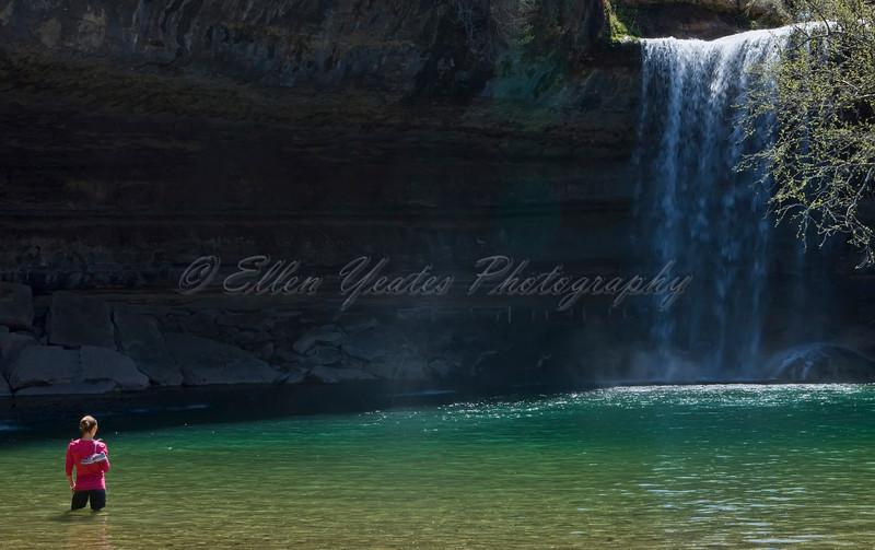 Lady watches waterfall