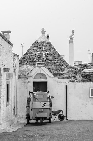 A three wheeled Piaggio Ape 50 in the streets of Alberobello