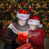 Ritika and Rohan (Santa's kids) enjoying opening there Christmas gifts