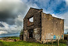 Derelict building on the bank of the Leeds - Liverpool canal near Altham Lancashire.