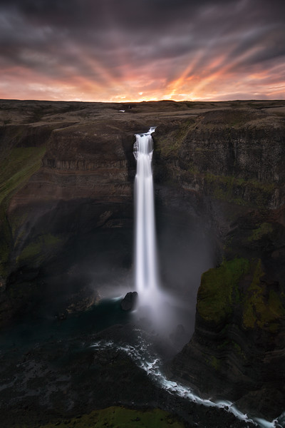 haifoss sunset iceland waterfall sunstreaks sunbeams light cloudy river.jpg