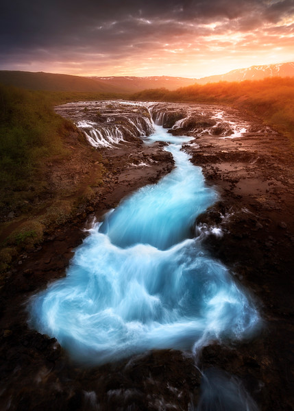 Bruarfoss iceland waterfall sunrise golden hour blue water.jpg