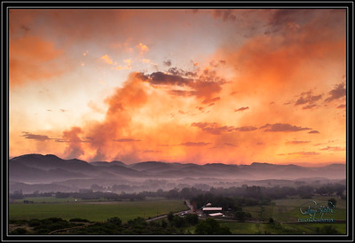 Smokey.  High Park Fire @ Bingham Hill.  One of the hardest hit areas is Rist Canyon.  Bingham Hill provides a view of the foothills of the area.  This was taken Wednesday evening June 13. The smoke is evident on the blackened foothills and a new round of fire is creating smoke as the fire moves west.  A beautiful sunset in a somber place.