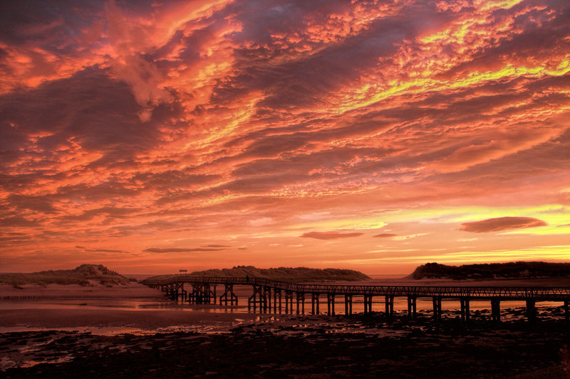 Sunrise at the bridge across the river at East Beach, Lossiemouth, Moray in Scotland.