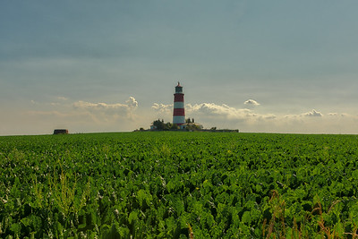 Happisburgh lighthouse on the horizon