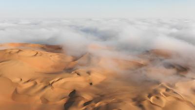Dense fog surrounding Empty Quarter dunes.