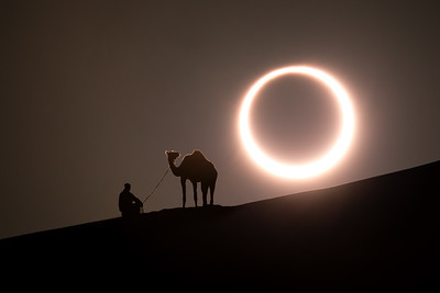 Annular solar eclipse with a silhouette of a camel.
