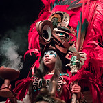 Woman in a Mayan warrior costume.