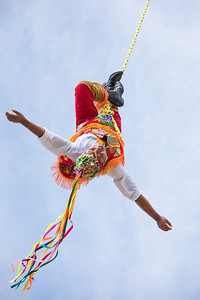 Voladores performing flying men show.