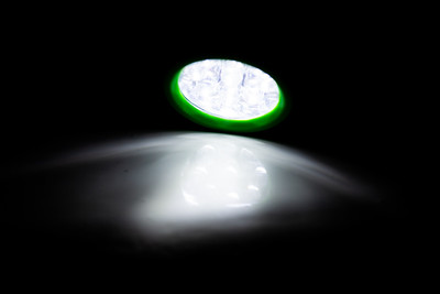 Green LED torch shining on a surface