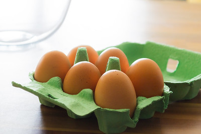 Six eggs in a green tray
