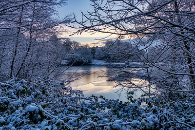 Frozen Lake at Corporation Park, Blackburn, Lancashire, UK
