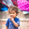 Young child spending time in Pashupatinah temple.