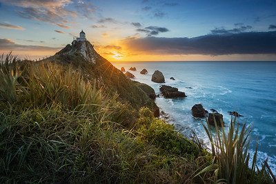 South Island, New Zealand: Nugget Point Lighthouse at sunrise.
