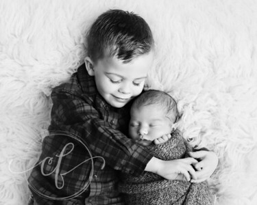 Sibling and newborn baby Photos