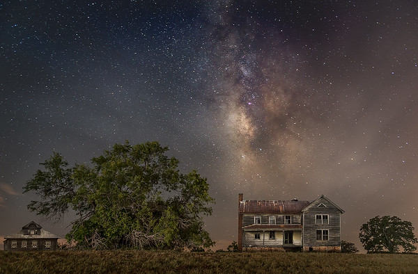 Abandoned houses under Milky Way in the woods near San Antonio