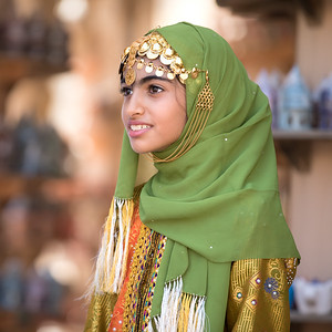 Portrait of a young Omani girl in the traditional outfit.