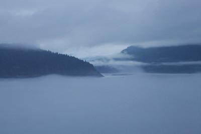 Inside Passage, Alaska The fog settles over the channels as we sail through the Inside Passage, Alaska.