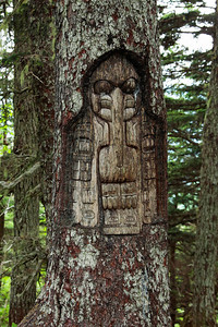 Juneau, Alaska Another Tlingit totem carved into a tree along the hiking trails on Mount Roberts in Juneau.