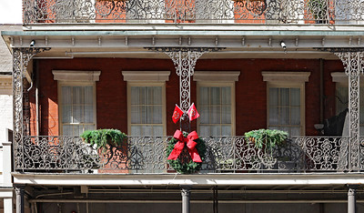 """French Quarter, New Orleans, Louisiana Lacy wrought iron balconies such as this line the narrow streets of the New Orleans historic Vieux Carré (French Quarter, literally translated as """"Old Square""""). They are one of the French Quarter's most prominent and memorable features."""