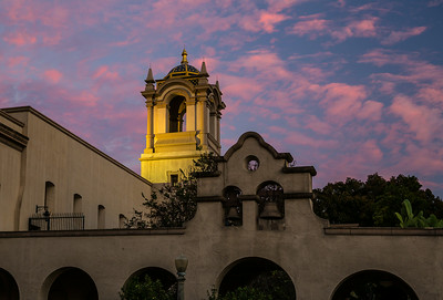 The tower over the San Diego Art Institute and Alcazar Gardens glows at sunset.