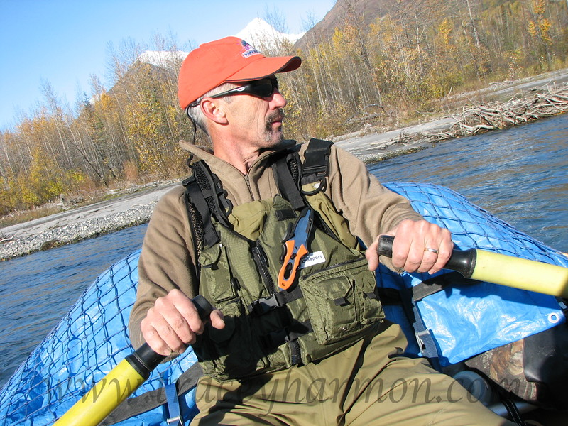 Tracey Harmon rowing a support boat down the Kichatna River in Alaska for Outdoor Life Magazine.