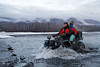 Barbara Gologergen and her daughter Alyssa cross Jim's Creek in Alaska.