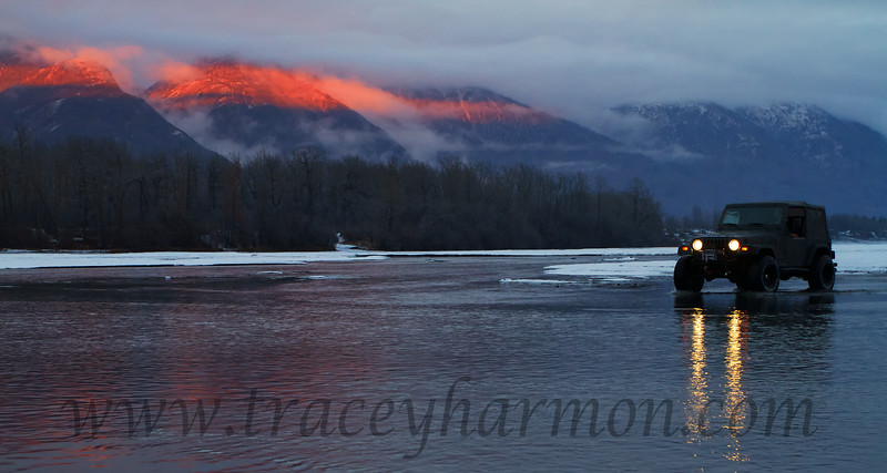 A silver of light is all the sunset Ernest Moore needs as he crosses Jim's Creek in Alaska.