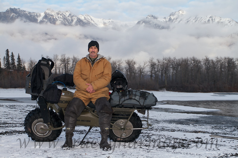 """Tracy Harmon taken' a break after crossing an arm of the Knik River in Alaska on a late October day. This was the maiden voyage of my new Rokon Trailbreaker (which can be found at  <a href=""""http://www.rokon.com"""">http://www.rokon.com</a>), a two wheel drive moto-tractor that will climb trees…if I could only manage to hang on!"""