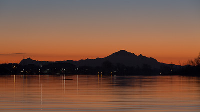 Mount Baker in Silhouette over Steveston waters.