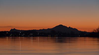 Mount Baker in Silhouette over Steveston waters.