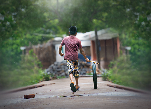 Hubballi Huduga (a boy from Hubballi playing local childhood game)