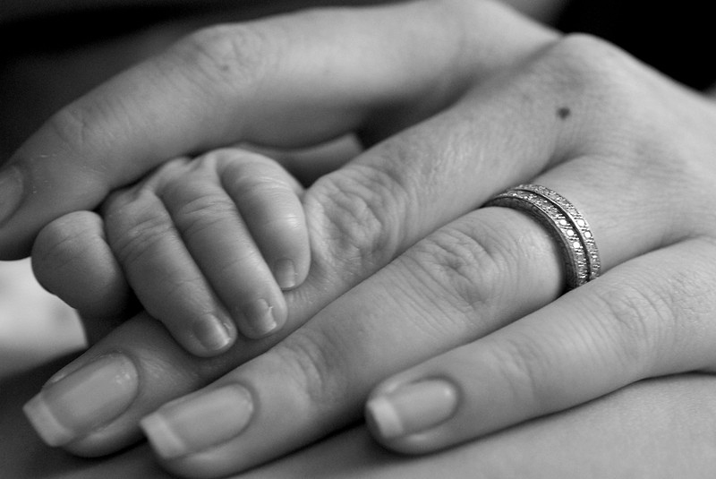 Although the sentimental ring was to be the focus of the photo, the tiny hand steals the show!