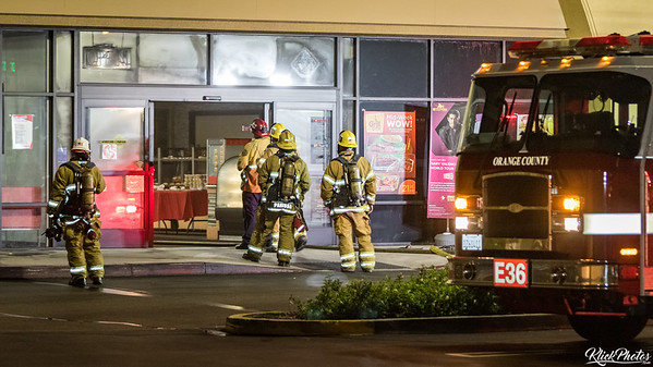 Firefighter enter the Seafood City Supermarket to analyze damage after extinguishing a blaze that broke out early Friday morning.