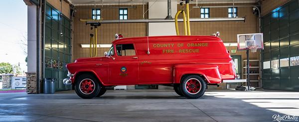 An older model GMC paramedic van rests inside the apparatus bay at OCFA's Fire Station 19.