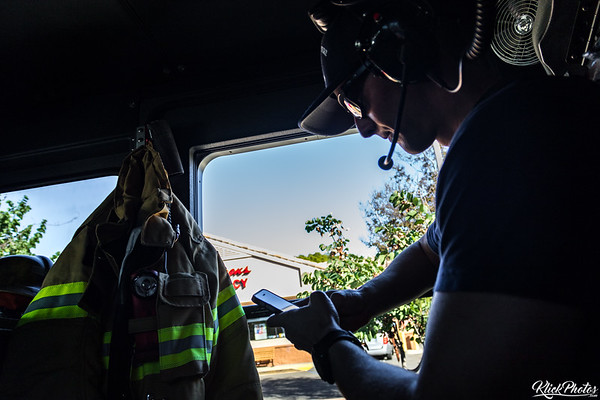 A firefighter assigned to OCFA's Engine 19 checks his phone while en route to lunch.