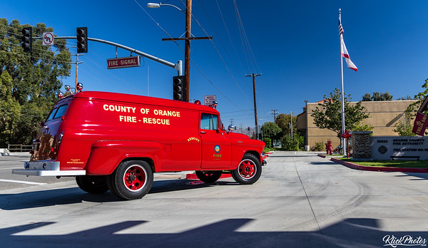 An older model GMC paramedic van restored by the Orange County Professional Firefighters Association is driven around the front parking lot of OCFA's Fire Station 19.