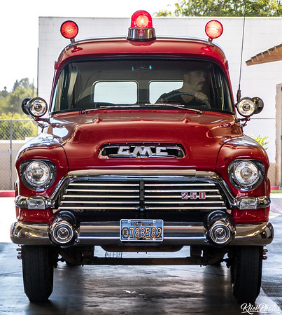 Engineer Wills activates the emergency lights on an older model GMC paramedic van restored by the Orange County Professional Firefighters Association. The paramedic van now rests inside the apparatus bay at OCFA's Fire Station 19.