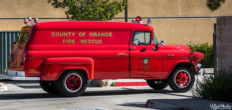 An older model GMC paramedic van is driven Code 3 into the rear parking lot at OCFA's Fire Station 19.