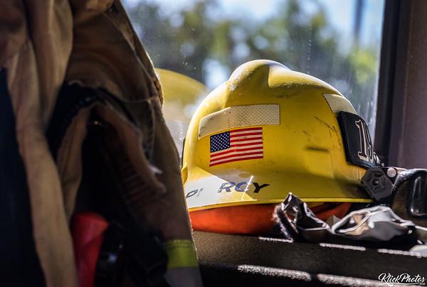 OCFA Firefighter Piercy's helmet sits inside of Engine 19 as the sun reflects off of it.