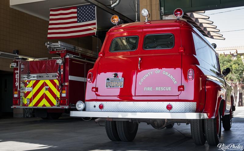 An older model GMC paramedic van rests alongside a 2013 KME Fire Apparatus inside the apparatus bay at OCFA's Fire Station 19.