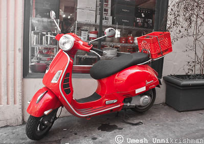 red scooter in the market