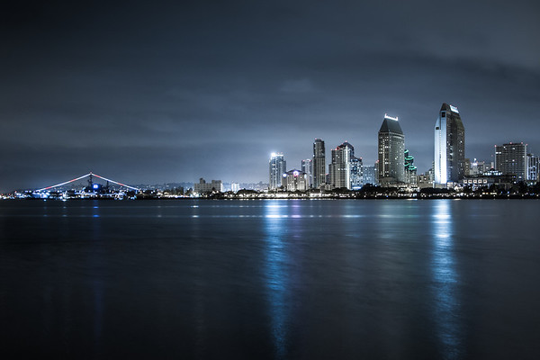 The San Diego, CA skyline at night seen across the bay from Coronado, CA including the USS Midway.  Taken by Justin Jarboe.
