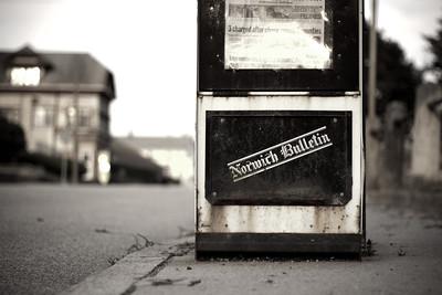 A Norwich Bulletin newspaper box. Taken by Nate Doggart in Putnam, CT.
