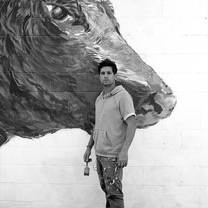 Artist and Forcado Donald Mota by his mural