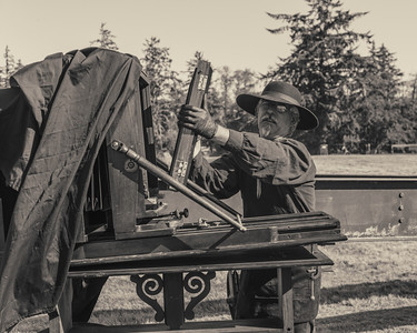 Loading the Wet Plate Dana Geraths prepares to make a Tintype of the 4th Regiment US Infantry at Fort Stevens on September 1st, 2012.