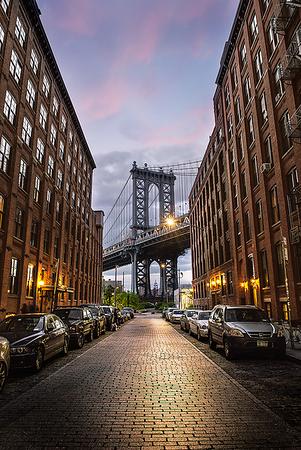 Empire state building viewing through Manhattan Bridge, New York City