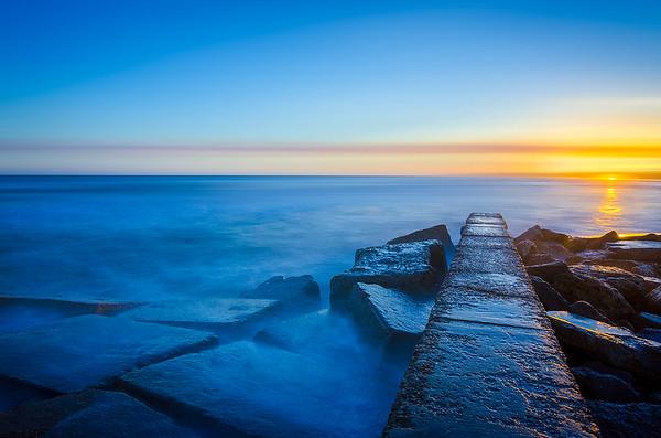 A beautiful smokey waves and grand sunset at Galveston Island, Texas (Long Exposure)