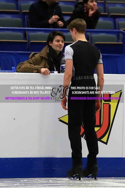 Deniss VASILJEVS LAT and Coach Stephane LAMBIEL